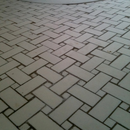 Repaired basketweave floor tiles