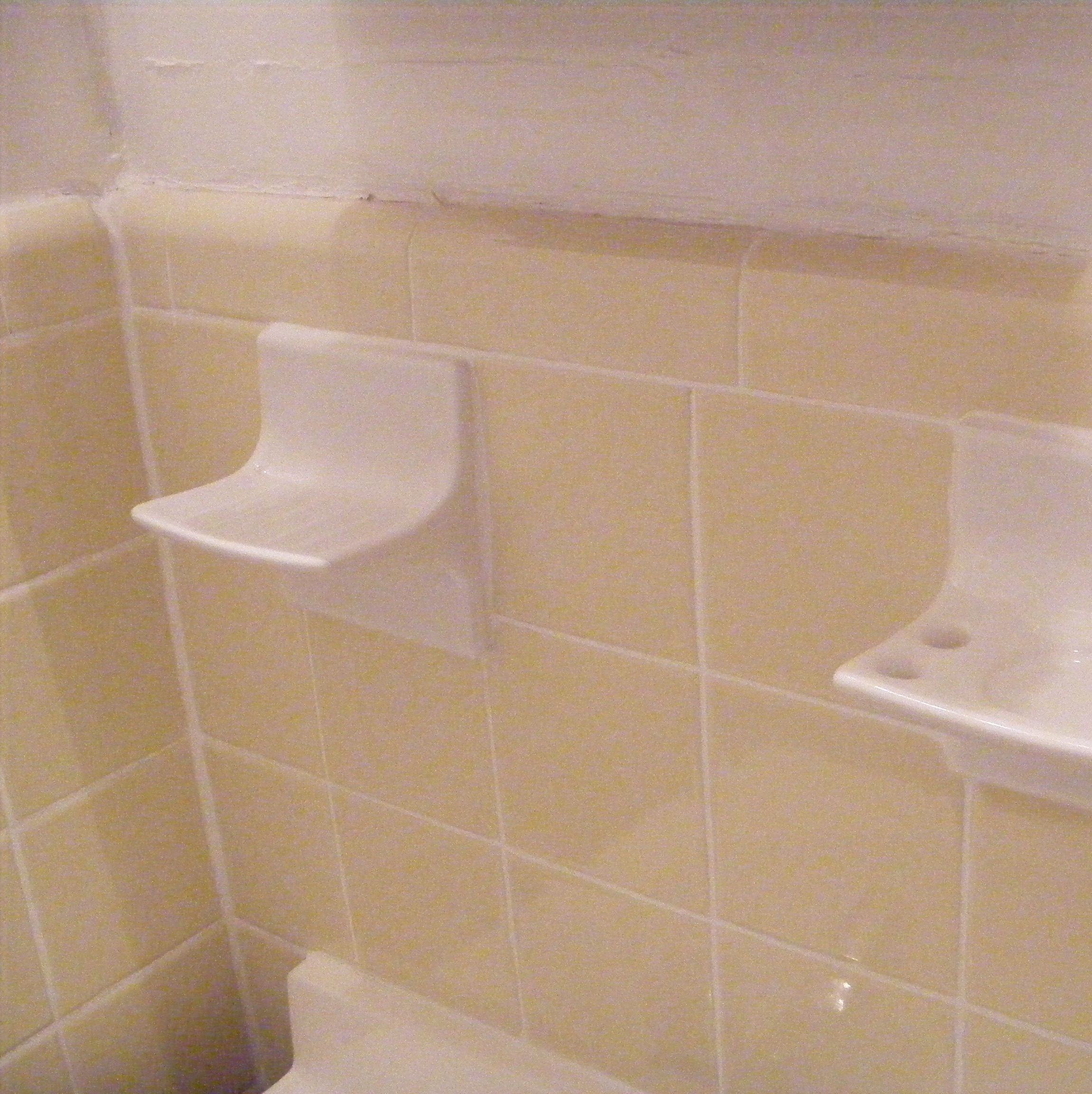 Bathroom tile toothbrush holder and soap holders both replaced to match and harmonize with existing toles