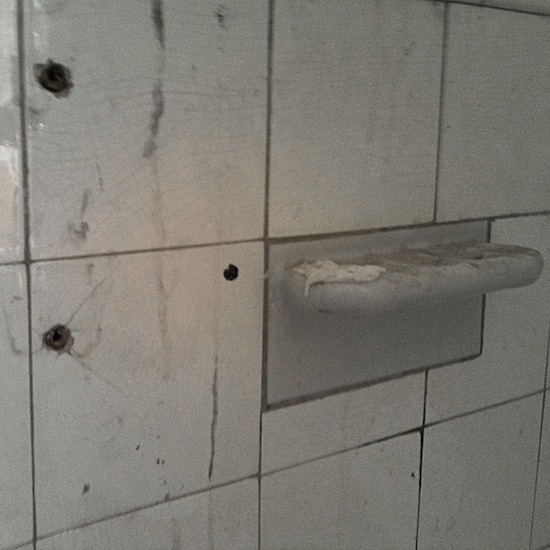 Cracked High Gloss Tile with holes from anchors before repair