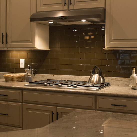 new brown glass subway tile kitchen backsplash