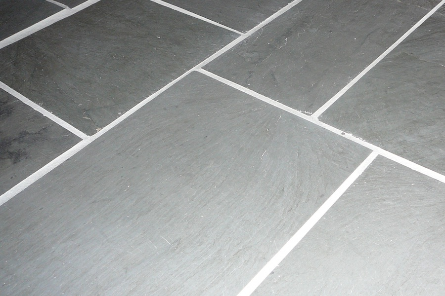 gray slate tile floor with light grout